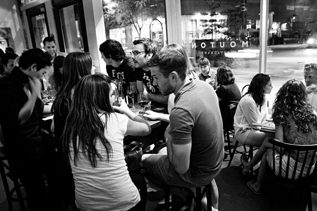 Mouton-Columbus-Nylon-Launch-Party-crowd-table-black-&-white-window