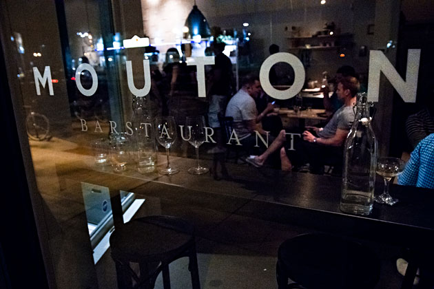 Mouton-Bar-restaurant-Columbus-Ohio-Short-North-Nylon-window-sign-glasses-people-crowd