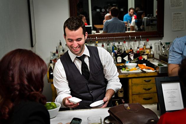 Mouton-Nylon-Columbus-drinks-bartender-behind-bar-laughing