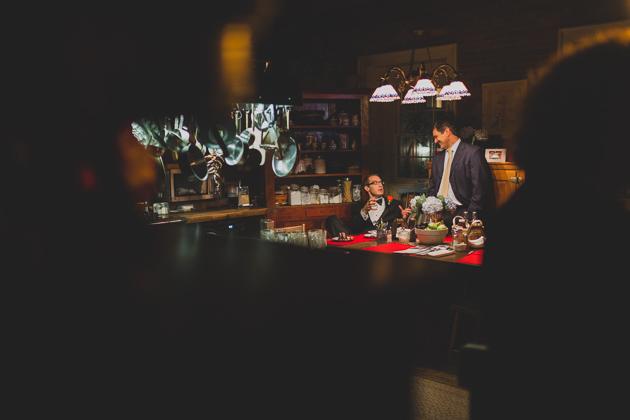 Groomsmen-Talking-In-Kittle-House-Kitchen-Wedding-Reception